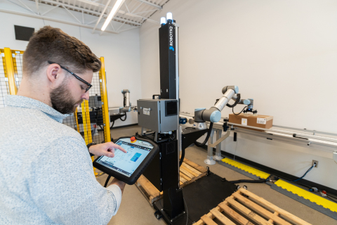 """Attendees at Universal Robots' PACK EXPO booth will experience firsthand the manifestation of """"ease of use"""" as the company's new and enhanced UR10e (payload 12.5kg) powers Robotiq's Palletizing Solution. (Photo: Business Wire)"""