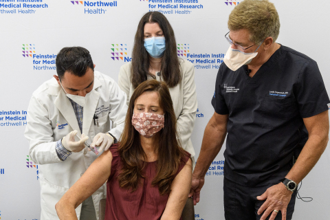 Darla Smyth (center) an organ transplant recipient receives her third dose of Moderna COVID-19 vaccine as part of a new clinical trial at the Feinstein Institutes. (Credit: Feinstein Institutes)