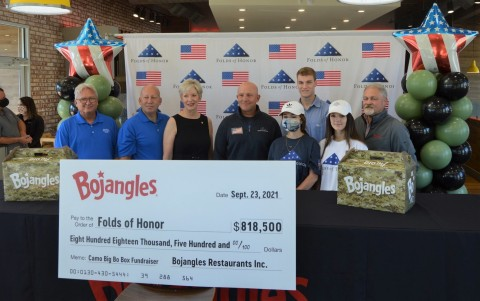 Bojangles presents Folds of Honor with $818,500 check raised from proceeds from its Camo Big Bo Box promotion. (Photo: Bojangles)
