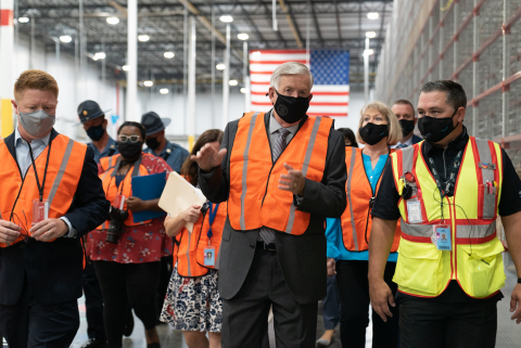 Missouri Gov. Mike Parson (center) tours Amazon's new fulfillment center - STL3 - in Republic, Mo. with STL3 General Manager Andrew Lee (right) and Republic Mayor Matt Russell (left). The facility has already created 1,400 good jobs that pay well with comprehensive benefits and offers upskilling programs to support associates' careers. It will create 400 more jobs by the holidays. Amazon has invested more than $2 billion into Missouri through infrastructure and compensation to its employees during the past decade, in addition to $1.5 billion being added into Missouri's state GDP with due to Amazon's investments. (Photo: Business Wire)