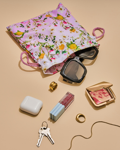 """Emblazoned with the cheeky reminder  """"More Gin Please,"""" the Cynthia Rowley x Gin Lane 1751 clutch not only holds the Gin Lane 1751 'Victoria' Pink Gin bottle, it also offers day-to-night versatility for holding the essentials for an on-the-go downtown lifestyle. (Photo: Business Wire)"""