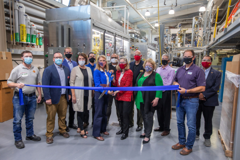 REG President & CEO, CJ Warner, and ISU President, Wendy Wintersteen, prepare to cut the ribbon in celebration of their collaboration on the new hydrotreater pilot plant. Photo courtesy of Christopher Gannon, Iowa State University. (Photo: Business Wire)