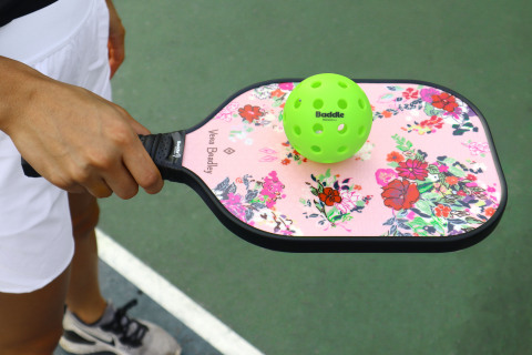 Vera Bradley partners with Baddle Pickleball on stylish new pickleball paddles and paddle covers. The Hope Blooms Pink pattern is shown here. Available on baddle.com and verabradley.com. (Photo: Business Wire)