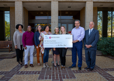 Officials from Red River Bank and Serving Grace pose with a ceremonial check to celebrate a $17,000 Partnership Grant Program award from the Federal Home Loan Bank of Dallas and Red River Bank. (Photo: Business Wire)