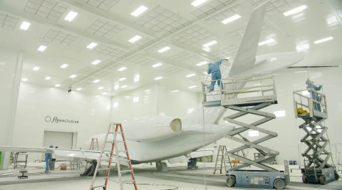 The flyExclusive electrostatic painting and coating facility delivers premium aircraft exterior design services for operators. (Photo: Business Wire)